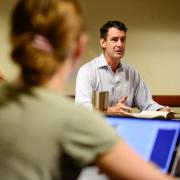 """Physics major Francesco Vassalli and environmental science major Jenna Engleken listen as lecturer Kane Turner talks during a discussion of """"The Republic"""" by Plato (photo by the Daily Camera)"""