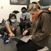 CU Boulder students Halle Sago, Ryan Carroll andSylvia Akoldiscuss data input for built environment surveys in Denver high school classrooms.