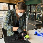 Rachel Sharpe works on a 3D printed mask component in the ITLL
