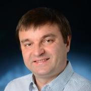 Professor Ivan Smalyukh in blue and white striped shirt
