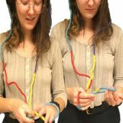 Klefeker plays with a length of string