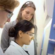 CU Boulder researcher Laurel Hind in her lab with students