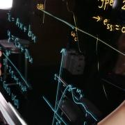 Lucy Pao works at markerboard in lab