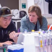 Professor Lynch with a student in the lab