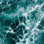 The ocean with waves as seen from the sky