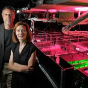 Physics professors Margaret Murnane and Henry Kapteyn of the Joint Institute for Laboratory Astrophysics (JILA) pose next to one of the laser apparatuses in their lab at the University of Colorado Boulder campus