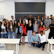 Students stand in a classroom in Lecco, Italy during a previous Global Intensive
