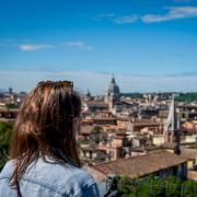 Woman looks over Rome city view