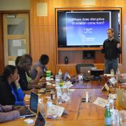 CU Boulder's Seth Miller discusses disruptive technologies with USTTI participants.