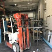 PhD student Sannidhya Ghosh uses a forklift to move concrete creep frames in the CIEST lab
