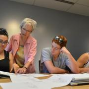 Students work with an instructor on a project.