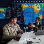 students Michael Klonowski, left, and Daniel Aguilar-Marsillach, right, work in the Raytheon Space & Intelligence Vision, Autonomy, and Decision Research Lab at CU Boulder,