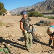 Zoey Craun uses a metal cutting saw on a Bridges to Prosperity job site in Bolivia.