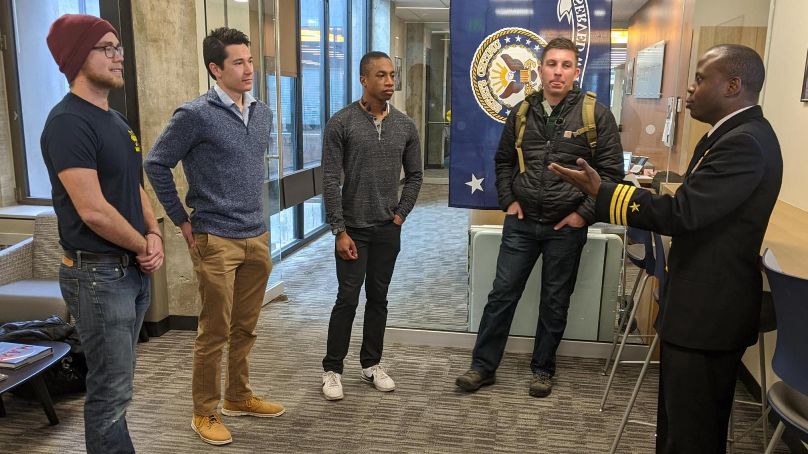 """Devin Lindsey and 3 other students chat with U.S. Navy Commander Robert """"Mac"""" McFarlin during his visit to CU Engineering."""