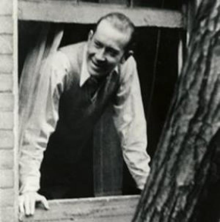 E.E. Cummings looking out of a window