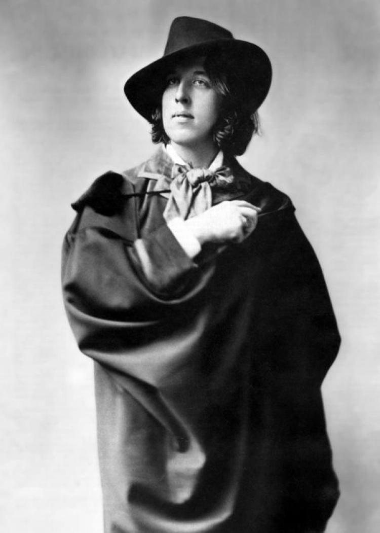 A man in a fancy brimmed hat