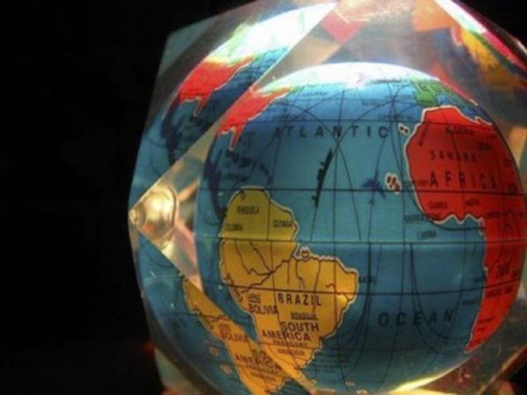 A globe in a glass cube