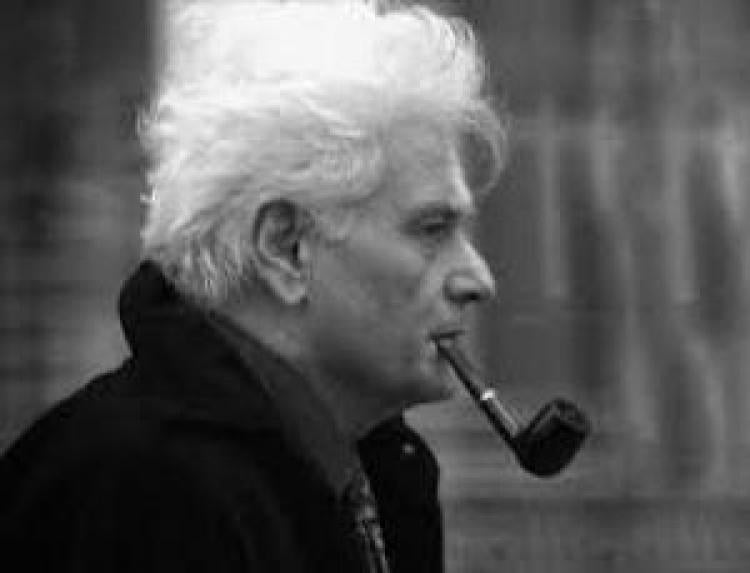 A man smoking a tobacco pipe