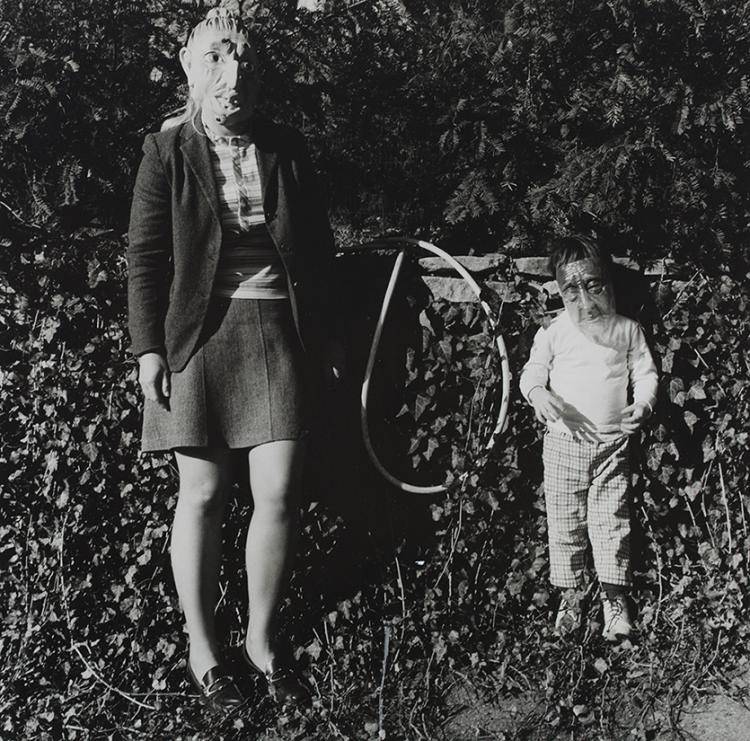 Photo of woman and child both wearing masks