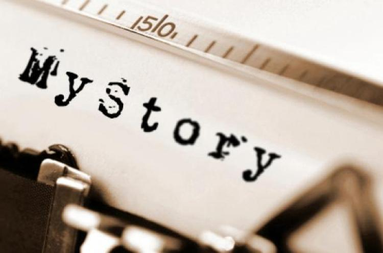 """Close up of a page that says """"My Story"""" loaded on a typewriter"""