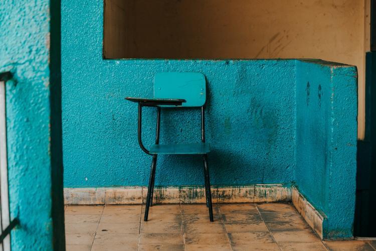 A blue chair against a blue wall