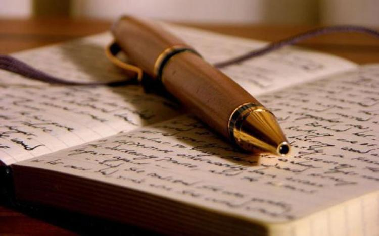 A fountain pen resting on an open book