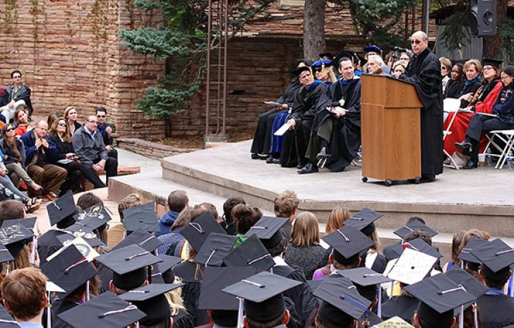 Art Kaufman speaking in front of student sat spring 2015 commencement