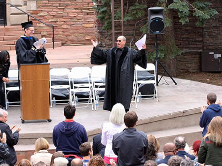 Art being applauded after his speech
