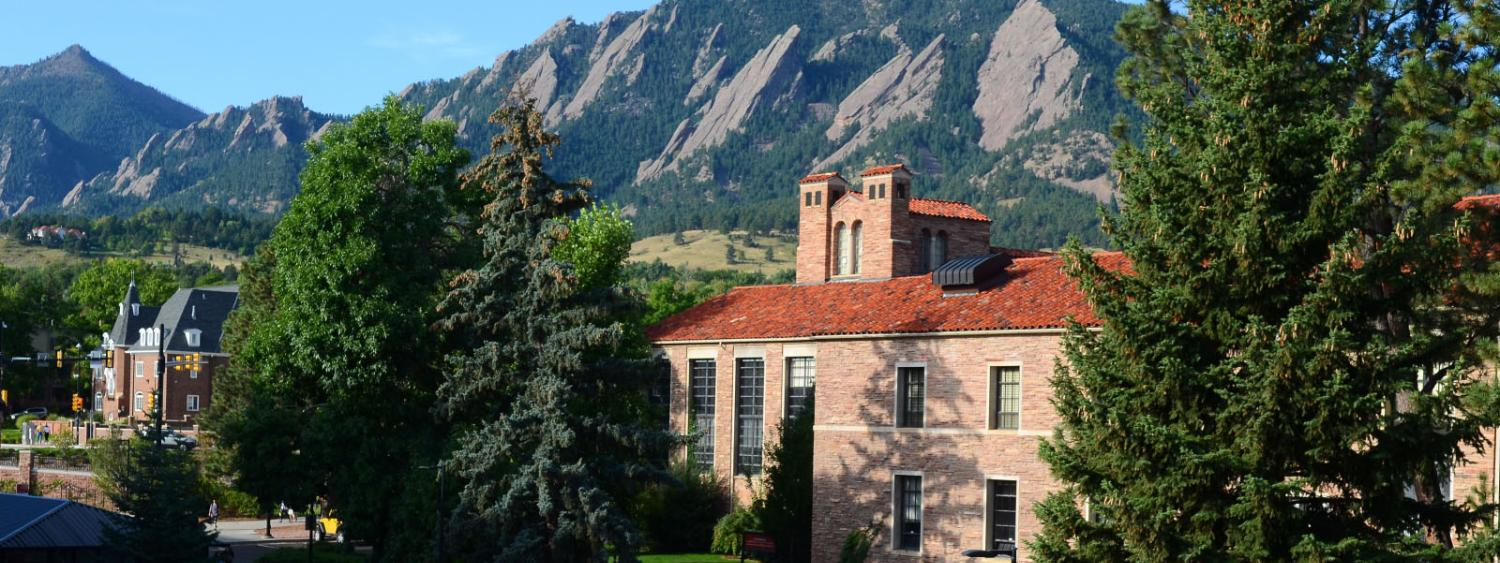 Hellems, home to the English Department, with the Flatirons in the background