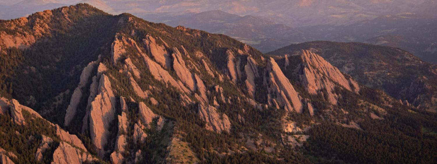 The flatirons being lit by early morning light.