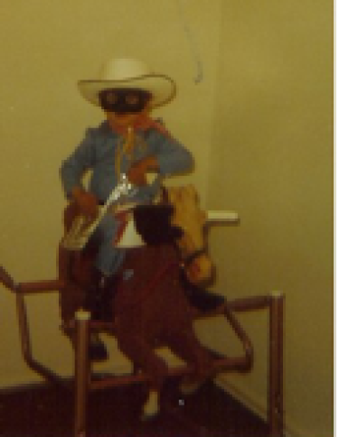 Curt as a young boy dressed as the Lone Ranger