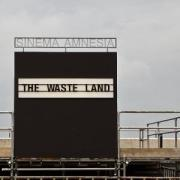 "A cinema sign that reads, ""Waste Land"""