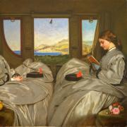 painting of two women reading in stage coach