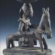 "A sculpture of a person on a horse with the words, ""Death and the King's Horseman"" written below it"