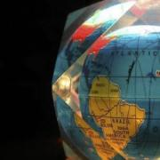 A globe in a glass cube