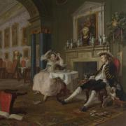 Painting of two men and a woman in a Victorian interior room