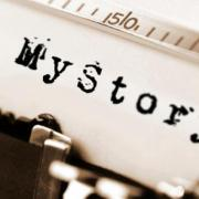 "Close up of a page that says ""My Story"" loaded on a typewriter"