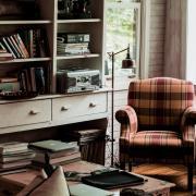 books on a table beside an armchair