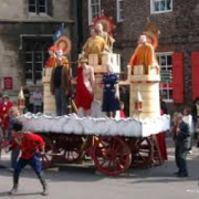 A parade of people in Medieval clothing