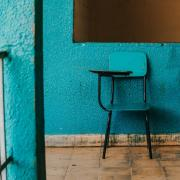 A blue chair against a blue wall