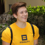 "Person wearing a T-shirt that says, ""equality"""