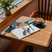 An open notebook on a table in the sunshine