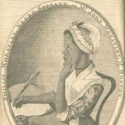 A woman at a desk writing