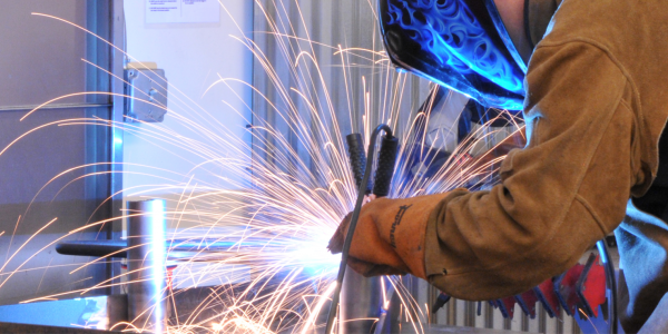 Student welding in the Creative Labs Center
