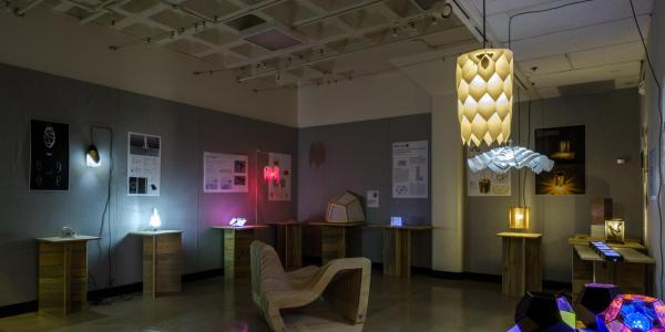 Overview photo of the Red Room Student Gallery, showcasing digitally-fabricated lamps.