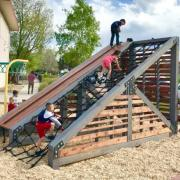 Children playing on a playground built by 18 student in the Program of Environmental Design in Lakewood, Colorado.