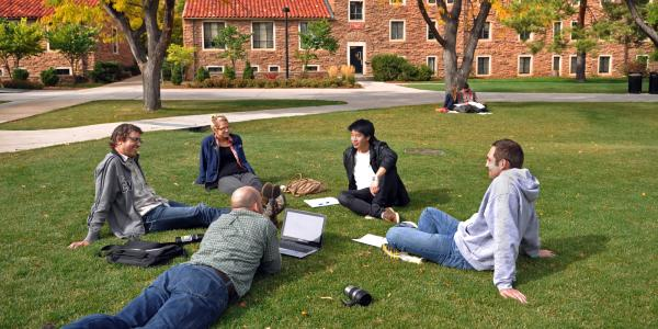 students studying outside in a circle