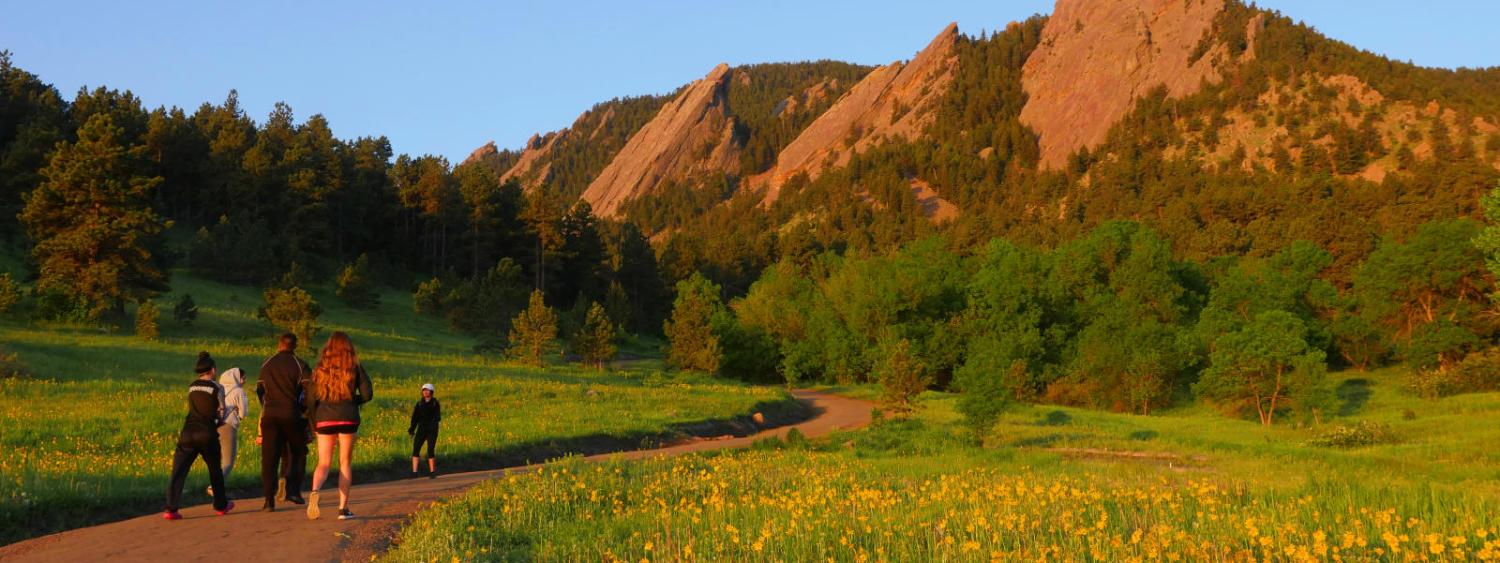people hiking chautauqua park at sunrise
