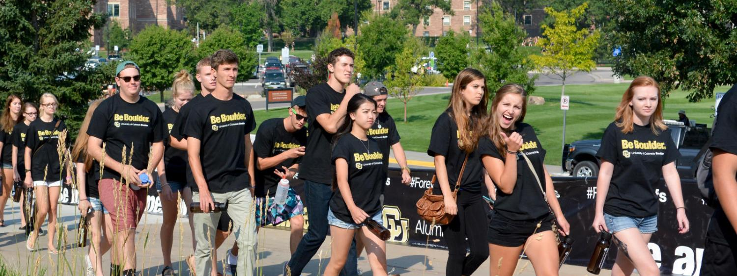 students walking to fall welcome week convocation event