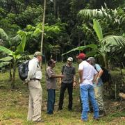 Together with colleagues from the Federal University of Acre, lead author Peter Newton talks with Sr. Dimas in his agroforest on the edge of the Amazonian forest in the state of Acre, Brazil.